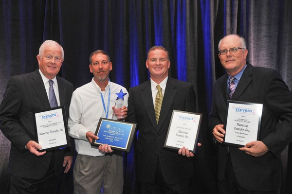 Manassas Transfer team accepting awards from Stevens at the moving convention
